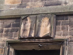 The bible above the door of the original Ragged School in Castle Hill, Edinburgh.  The text says 'Search the Scriptures' from John 5 v 39.